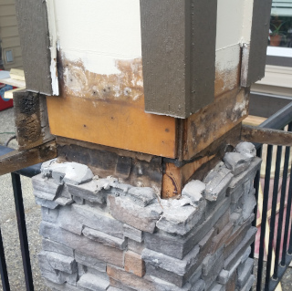 An exterior column on a porch being repaired.